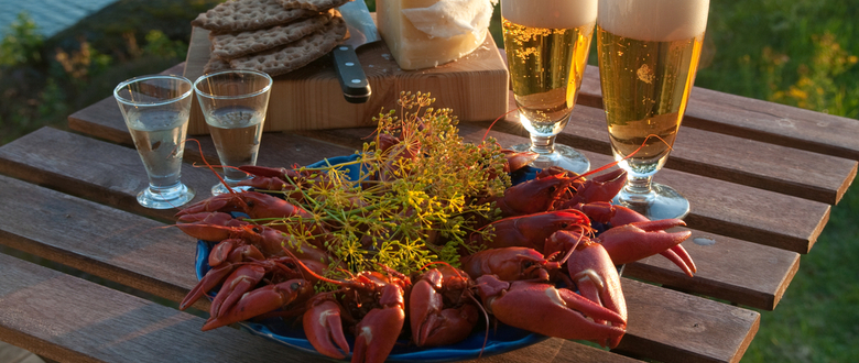 Photo of nordic crayfish style crawfish boil served with fresh dill and beer